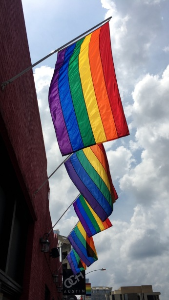 Pride flags outside Austin's gay clubs, June 6th, 2016. © J.T. Fales